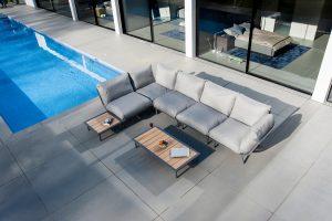 sofa set next to pool